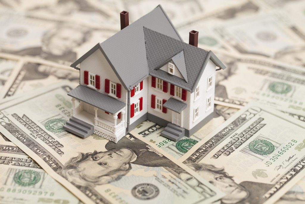 small house on top of us dollars