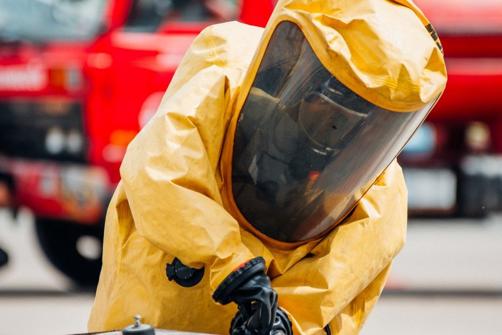 Firefighter protecting himself from chemical leak
