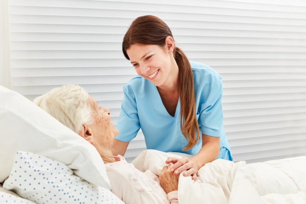 nurse taking care of an elderly