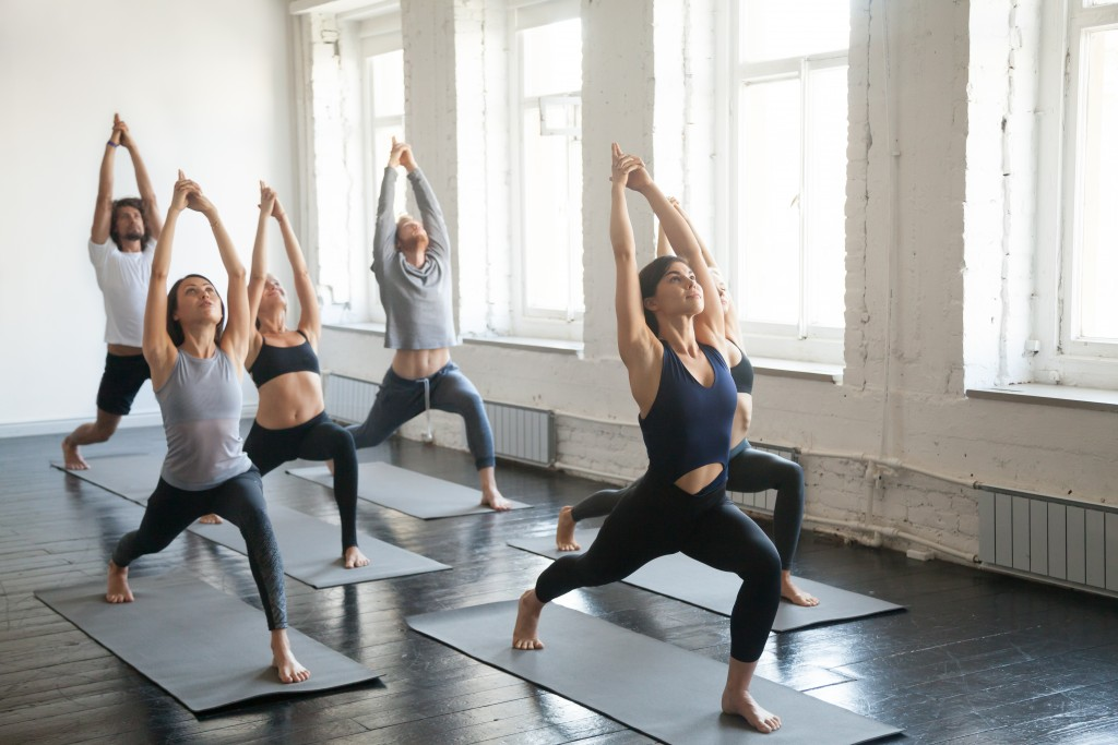 Group of people doing yoga