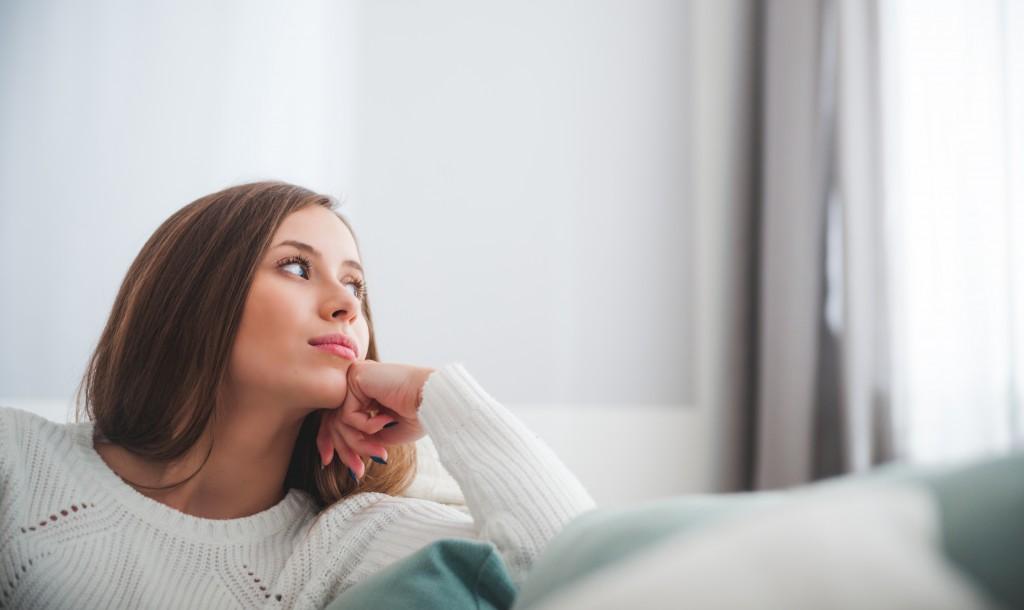 Woman looking outside sad
