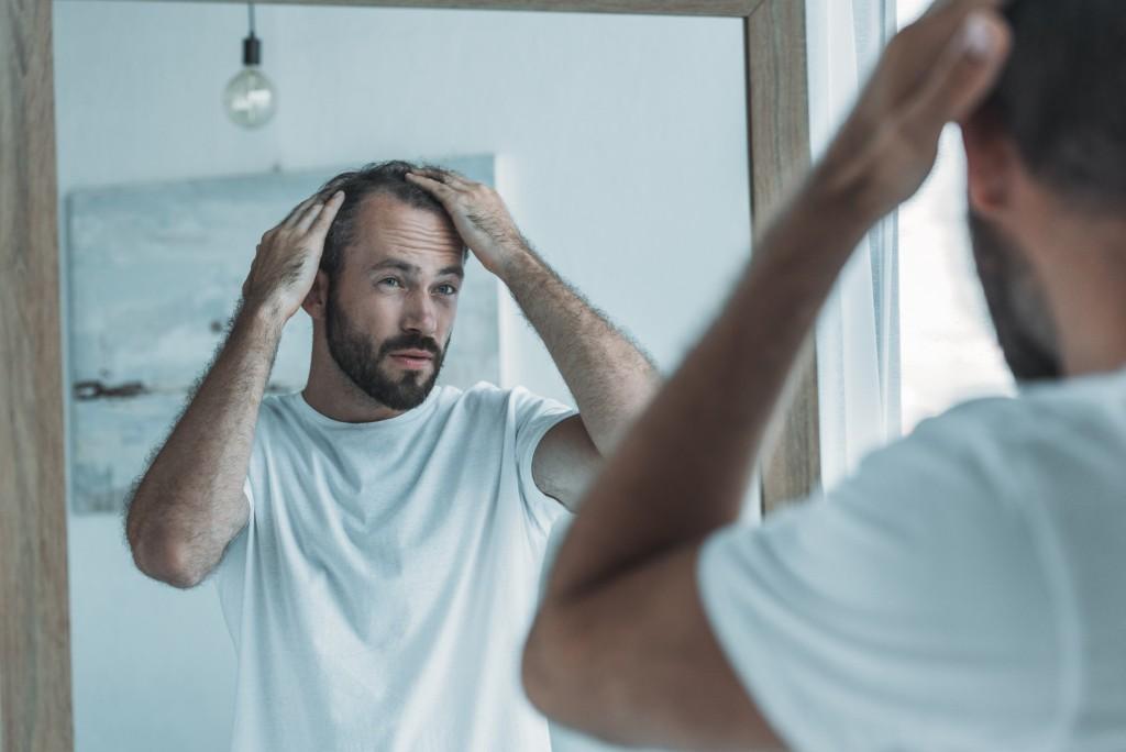 Man touching his hair