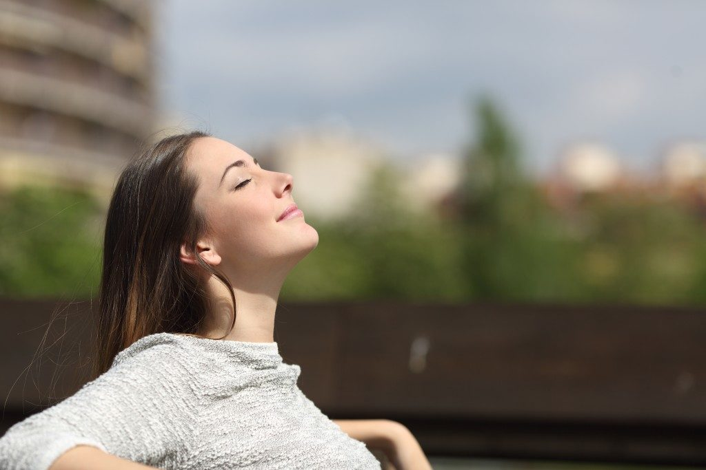 woman enjoing fresh air outside