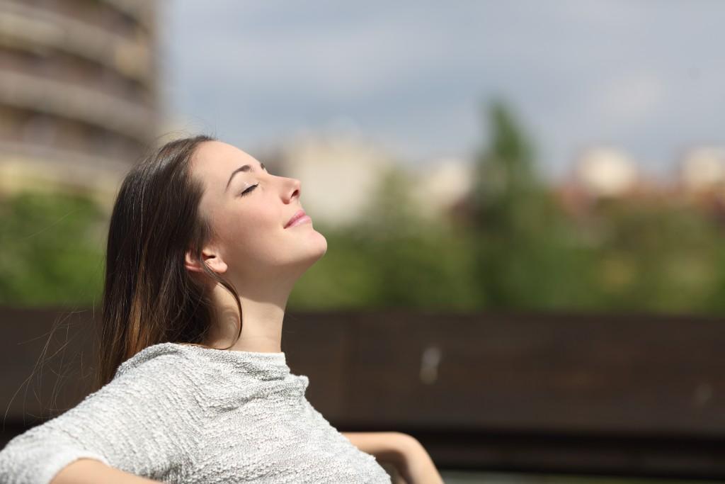 woman enjoing fresh air outside