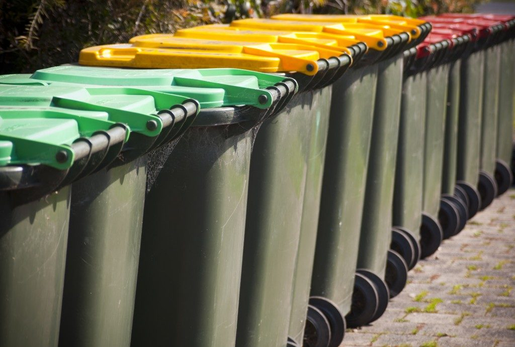 row of garbage bins