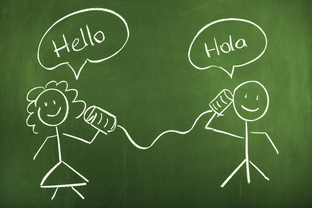 chalk drawing saying hello in spanish and english