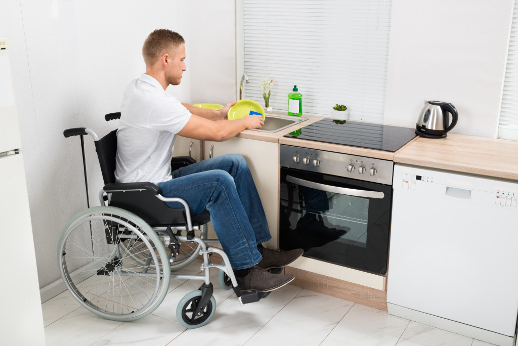 disabled man washing dishes